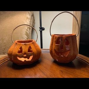 Two pumpkins with handles